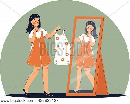 Girl Trying On Dress In Clothing Store. Shopping. Woman Buys A Fashionable, Beautiful Dress.