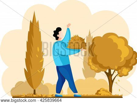 Man Gardener Worker Collects Fallen Leaves From Trees From Ground, Works On Farm. Agricultural Worke