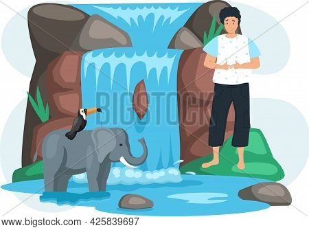 Guy Looks At Animals Near Waterfall In Green Forest. Toucan Sits On Elephant On Its Back In Beautifu