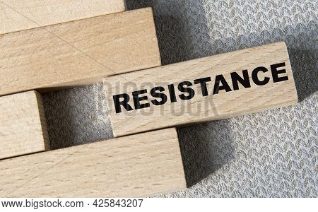 Resistance - Word On A Wooden Bar On A Gray Background. Business Concept