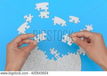Jigsaw Connection, Jigsaw Puzzle In The Hand Of A Businessman,  Business Team Assembling Jigsaw Puzz