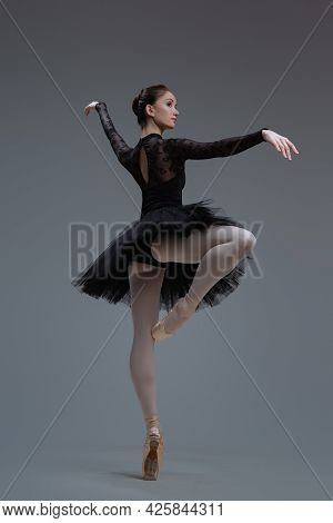 Dancing Ballerina Dressed In Black Tutu With Skirt