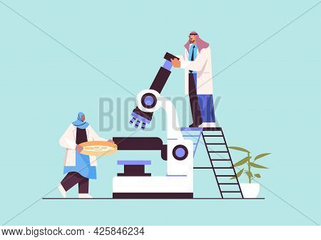 Arab Research Scientist Team Working With Microscope Researchers Making Chemical Experiment In Labor