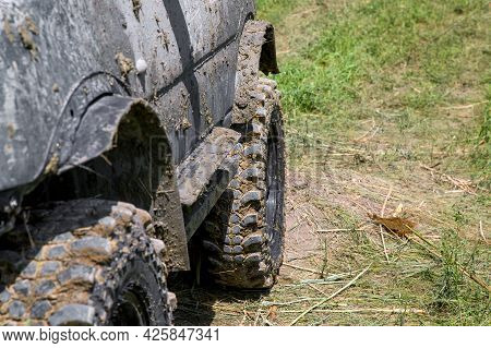 Wheels Of A Dirty Car In A Rural Landscape With Dirt Off-road Close Up, A Side View Of An Off-road V