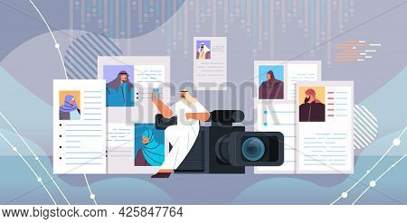 Arab Hr Manager With Video Camera Choosing Resume Curriculum Vitae With Photo And Personal Info