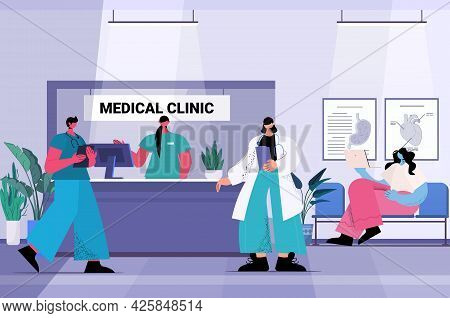 Patients And Medical Clinic Workers In Hospital Corridor Healthcare Concept Full Length