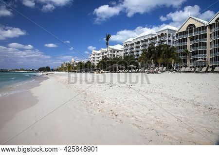 Grand Cayman, Cayman Islands - March 8, 2013:  Luxury Hotels And Resorts Line The White Sandy Beache