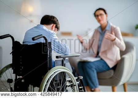Psychological Help For Disabled People. Handicapped Adolescent Crying During Consultation With Psych