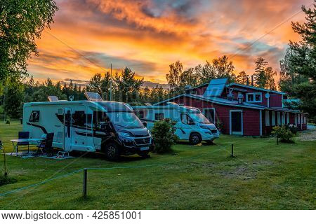 Hallefors, Sweden - 4 July, 2021: Beautiful Sunset At A Swedish Campground In The Forest With A Red