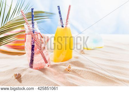 Healthy Summer Beach Vacation On Ocean Coast With Sea View - Fresh Cold  Juices In Glass Bottles Wit