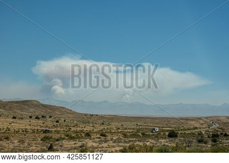 Two Forest Fires In The Distance Near Grand Junction Colorado In Summer Of 2020
