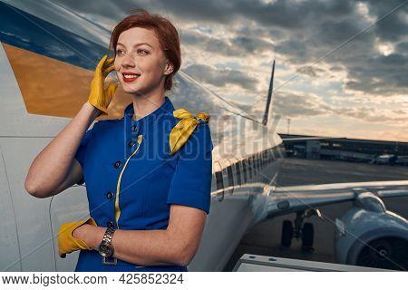 Lovely Joyous Female Flight Attendant Looking Away