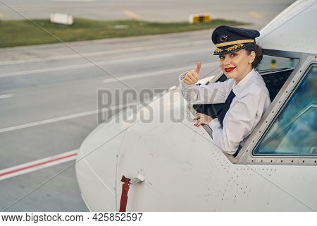Airline Pilot Showing Her Readiness For Take-off