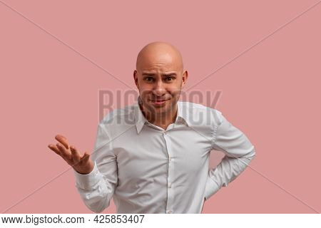 Folly Act. Confused Bald Guy With Bristle In White Shirt Gesture With Puzzlement, Being Displeased W