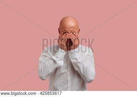 Portrait Of Upset Bald Man With Bristle In White Shirt, Rubs Tears, Feels Badly With His Problems. P