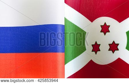 Fragments Of The State Flags Of Russia And The Republic Of Burundi Close-up