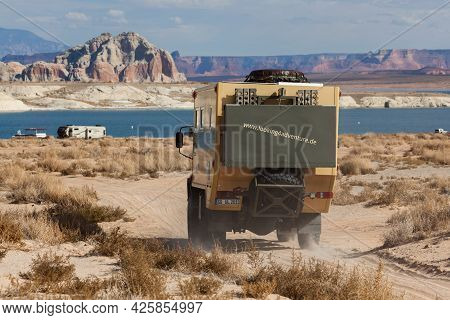 Lake Powell, Utah, Usa - October 31, 2014:  An Extreme Off-road Camping Vehicle Drives On A Sand Pat