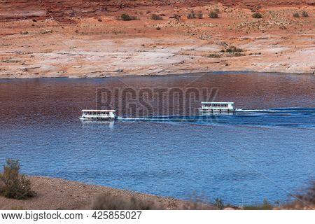 Page, Arizona, Usa - October 31, 2014:  Two Sightseeing Cruise Boats Navigating On Lake Powell Near