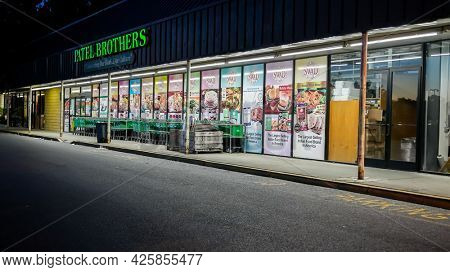 NORWALK, CT, USA - JUNE, 24, 2021: Patel Brothers store front with evening lights