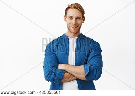 Confident Handsome Redhead Man With Arms Crossed Over Body, Smiling And Looking Determined Like Prof