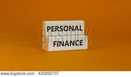 Personal Finance Symbol. Wooden Blocks With Words Personal Finance On Beautiful Orange Background, C