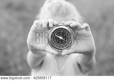 Old Classic Navigation Compass In Hands On Natural Background As Symbol Of Tourism With Compass, Tra