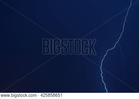 Thunderstorm. Lightning In The Night Blue Sky