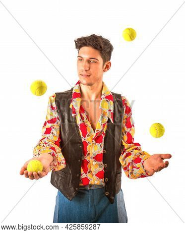 Young Man Juggling Tennis Balls Isolated On White