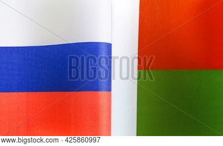 Fragments Of The National Flags Of Russia And The Republic Of Madagascar Close-up