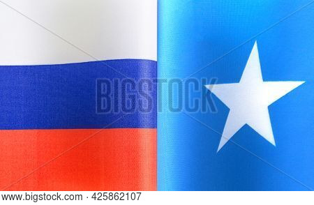 Fragments Of The National Flags Of Russia And The Federal Republic Of Somalia Close-up