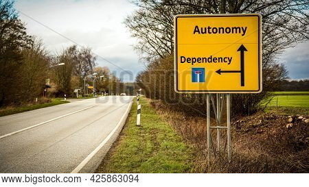 Street Sign The Direction Way To Autonomy Versus Dependency