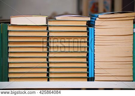 Stacks Of Books On A Shelf In The Library
