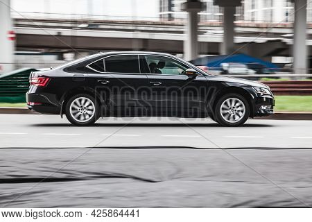 Moscow, Russia - May 2021: Fast Moving Skoda Superb B8 On The City Road. Black Sedan Rides On Street