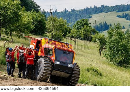 Nizhniy Studeny, Ukraine - July 2, 2021: Ukrainian Mountain Rescuers, After Providing First Aid, Eva