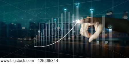Double Exposure Of Businessman Hand Pointing Arrow Graph And Chart. Business Growth And Increase Of