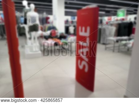 Blurred Sales Sign Fifty Percent Discount On Sign On Shop Window.