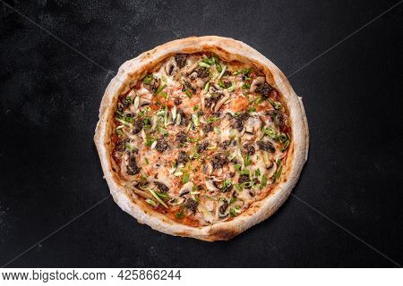 Fresh Delicious Italian Pizza With Meat, Mushrooms And Tomatoes On A Dark Concrete Background