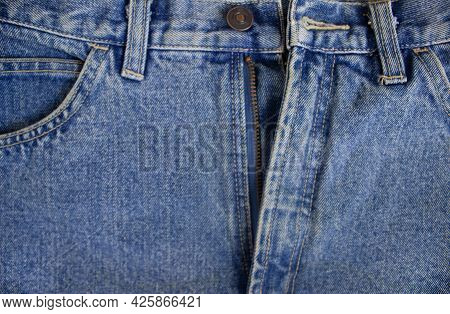 Close-up Texture Of Denim Color Fabric Or Cloth In Denim Color. Fabric Texture Of Denim Background
