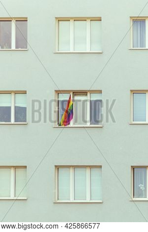 The Lgbt Flag Hangs On The Window. The Lgbt Flag Hangs On The Facade Of The Building. The Concept Of