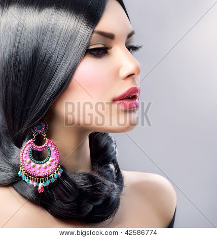 Beauty Woman With Long Black Hair. Hairstyle. Beautiful Model Girl Portrait. Earrings. Accessory