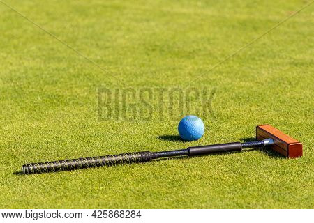 Croquet Mallet And Ball On A Lgreen Awn
