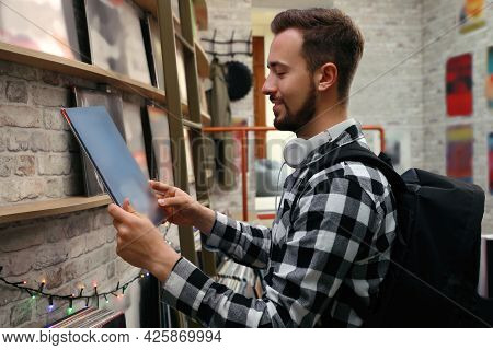 Young Man With Vinyl Record In Store