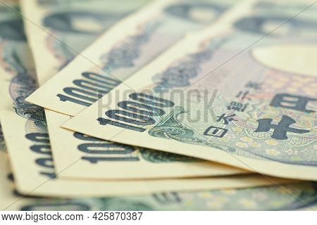 Close-up Of Several Japanese 1,000 Yen Bills. Background Or Backdrop About Money, Bookkeeping And Th