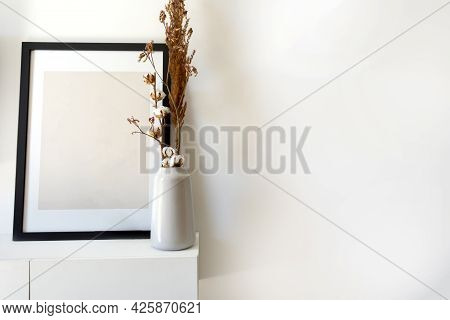 Empty Wooden Photo,picture Frame Mock-up With White Vase And Stylish Plant Near White Wall On Table,