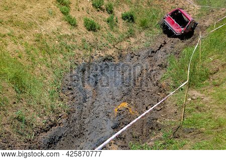 An Open Pit With Slopes And Off-road Terrain For Competition Driving Through The Swamp On Off-road V