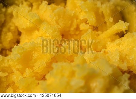 Close Up Of Yellow Clarified Butter Ghee Structure.