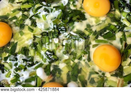 Scrambled Eggs With Green Spring Onions In The Pan.