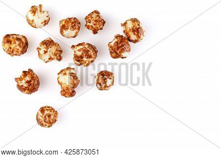 Heap Of Delicious Popcorn Covered With Milk Chocolate Isolated On White Background . Scattered Popco
