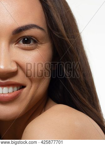 Half Beauty Portriet Woman Smiling At The Camera With A Snow-white Smooth. Beautiful Natural Makeup,