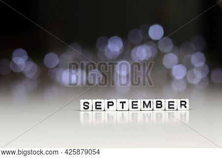 September Word Written On Wood Block. September Text On Wooden Table For Your Desing, Top View Conce
